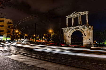 Light trails of moving cars under Hadrian gate 写真素材