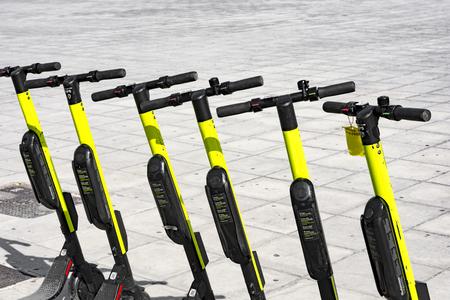 few electric scooters parked waiting for someone to pick them Zdjęcie Seryjne