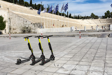 few electric scooters parked outside the panathenaic stadium in Greece