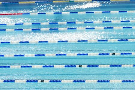 competition swimming lanes in a large swimming pool on a sunny day Zdjęcie Seryjne