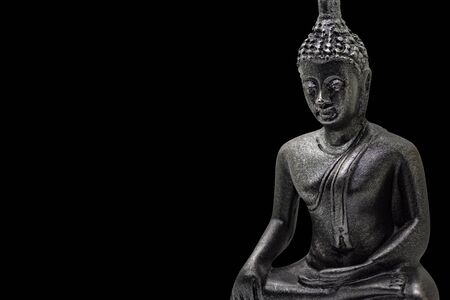 Photo of little buddha sitting from black stone isolated Standard-Bild