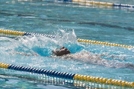A Paraplegic man Swims In a Pool backstroke