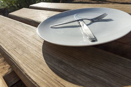Empty plate with knife and fork - food outside the house project