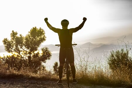 Success, achievement, accomplishment and winning concept with male mountain biker
