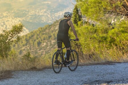 male athletic cyclist riding on a mountain path - extrerme sports project