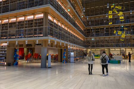 couple visits new modern public library - education and information place