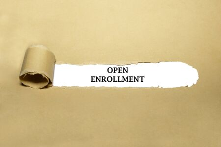 Text Open Enrollment appearing behind torn brown paper.