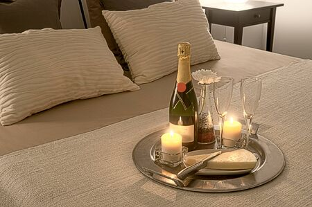 romance in bed with bottle of champagne - romantic mood Zdjęcie Seryjne
