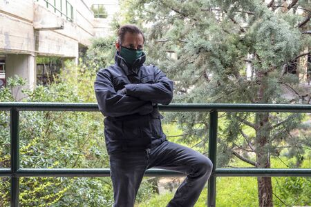 Man wearing mask and gloves during covid 19 pandemic standing and looking worried and troubled