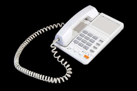 White phone isolated on black photo