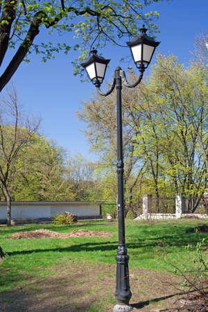 City lantern in park at spring  photo