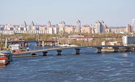 Kiev cityscape with bridge at sunny day photo