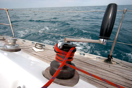 winch: Winch with rope on sailing boat in the sea