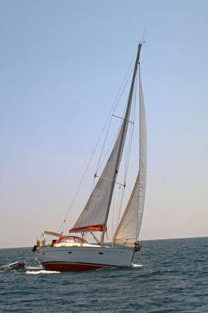 Turning sailing boat on the sea photo
