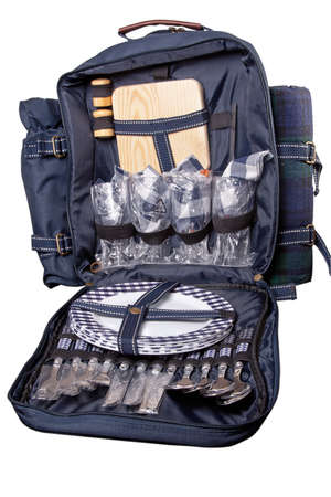 Backpack with dinner set for picnic photo