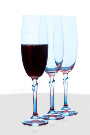 Three wine glasses, one with wine photo