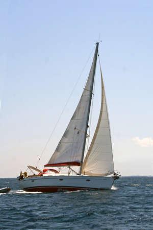 Turning sailing boat on the sea Standard-Bild