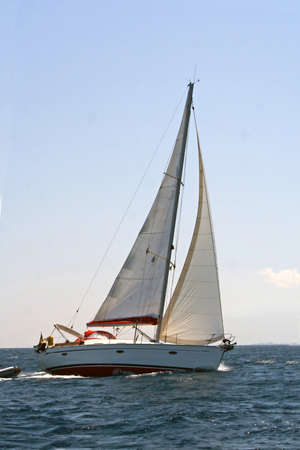 Turning sailing boat on the sea photo