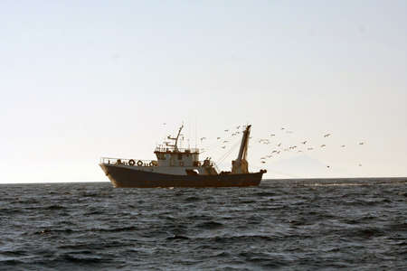Fisher ship in the sea  photo