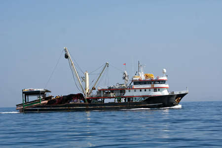 Fisher ship in the sea