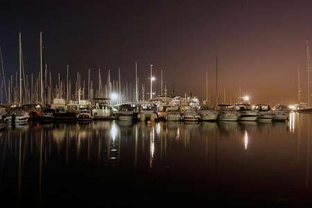 Yachts at night in marine  photo