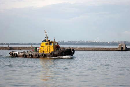 Tugboat: Moving tugboat in marina