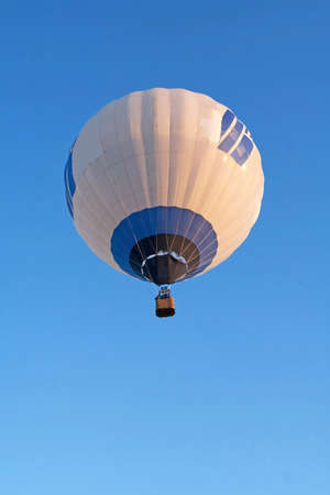 Flying balloon with many patches at sunrise Stock Photo - 7422271