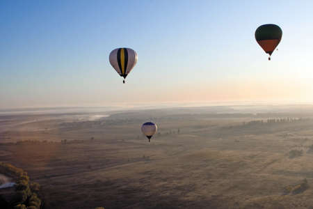 Flying balloons at sunrise Stock Photo - 7422266