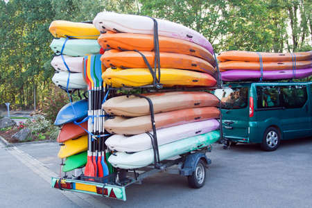 Car with trailer with kayaks and paddles