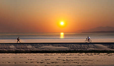 Biker and hiker moving in sunset Stock Photo - 7452785