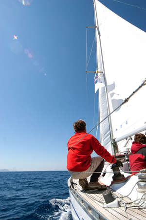 boat crew: People on sailing boat on the sea