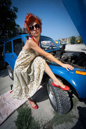 Vintage girl posing in front of the car Stock Photo - 7891215