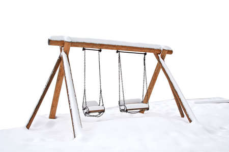 Swings covered with snow photo