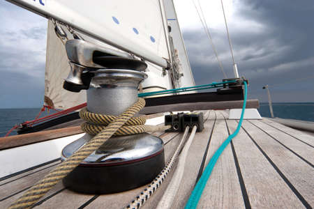 boat deck: Winch with rope on sailing boat in the sea