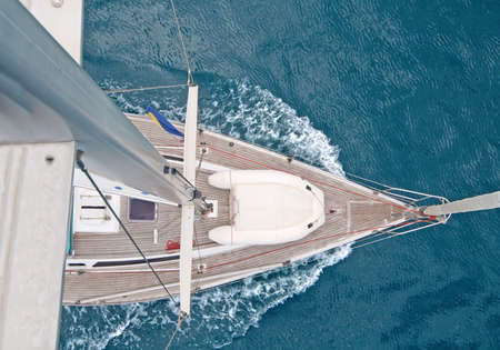 yacht race: Top view of sailing boat with water splash