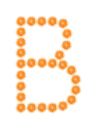 Letter B from orange slices isolated on white background  photo