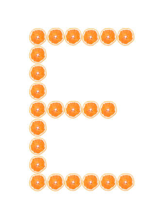 Letter E from orange slices isolated on white background  photo