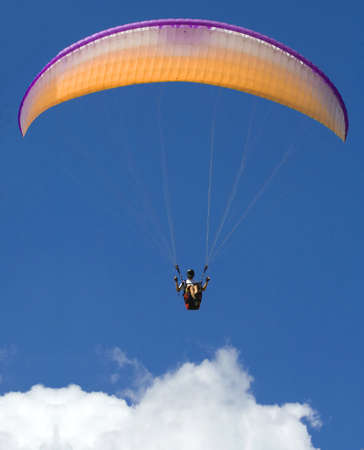 Paraglider above the cloud