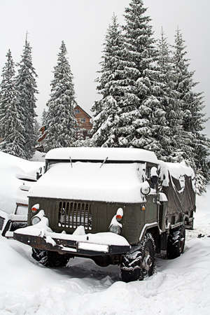 Truck covered with snow photo