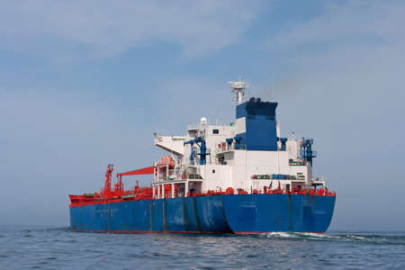 Tanker sailing in the sea with water splashes from engine Standard-Bild