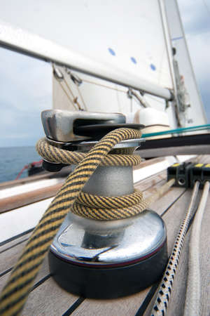 Winch with rope on sailing boat in the sea photo