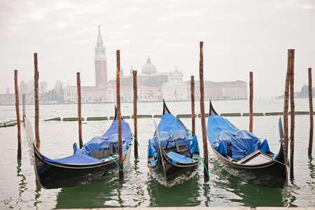 Three gondolas in Venice at the pier