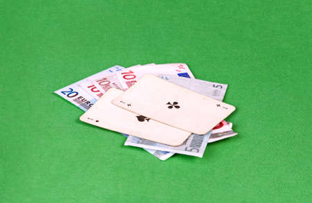 Two aces with euros on green gambling table  photo