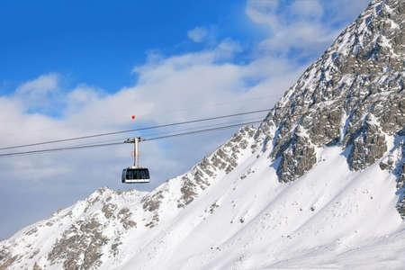 Gondola on cable on Switzerland mountain resort  photo