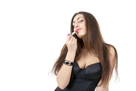 Pretty girl doing makeup with red lipstick isolated on white background Stock Photo - 8819612