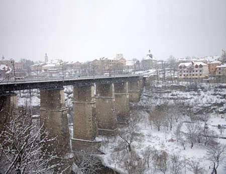 Bridge across the river under snow in winter photo