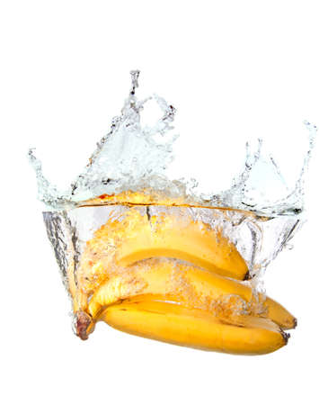 light meal: Bunch of bananas in water splash isolated on white background