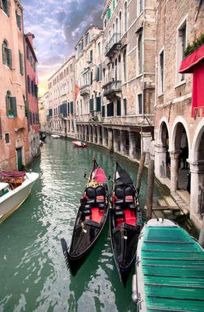Two gondola in Venice near pier at sunset  Standard-Bild