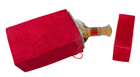 Bottle in the red velour box isolated on white background photo