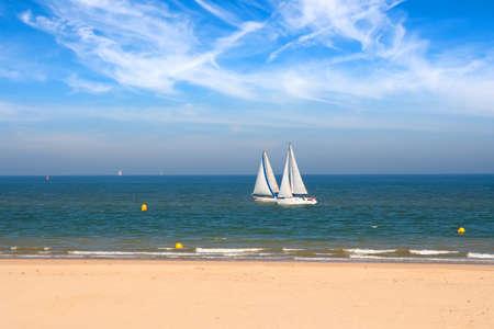 Two yachts racing near seashore in the Pas-de-Calais, France